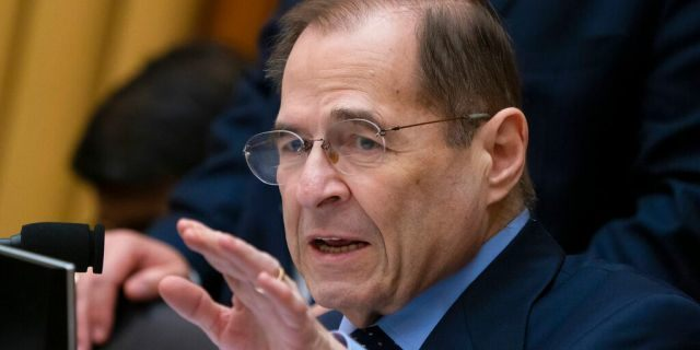 In this Feb. 8, 2019, photo, House Judiciary Committee Chairman Jerrold Nadler, D-N.Y., gestures during questioning of acting Attorney General Matthew Whitaker on Capitol Hill in Washington. A key House committee has approved a bill to require background checks for all sales and transfers of firearms, a first by majority Democrats to tighten gun laws after eight years of Republican rule. (AP Photo/J. Scott Applewhite)