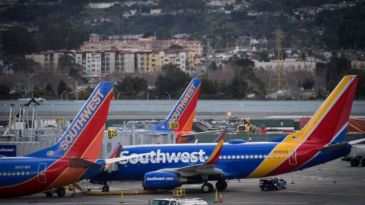 Southwest Airlines Co. planes stand on the tarmac at San Francisco International Airport (SFO) in San Francisco, California, U.S., on Friday, Jan. 19, 2018. Southwest Airlines Co. is scheduled to release earnings on January 25. Photographer: David Paul Morris/Bloomberg via Getty Images