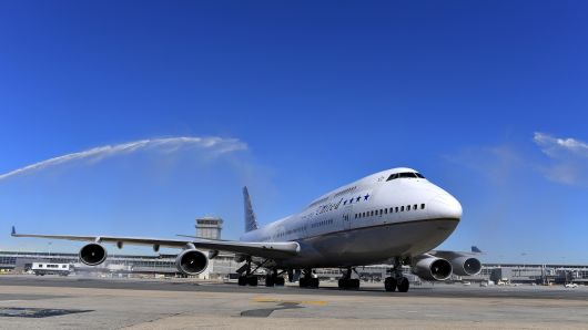 The last United Airlines 747 is greeted by water cannons after it makes its final landing at Dulles International Airport October 19, 2017 in Dulles, VA.