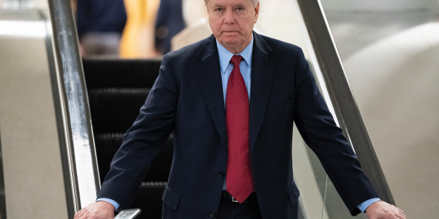 Senate Judiciary Committee Chairman Lindsey Graham, R-S.C., an ally of President Donald Trump, leaves the Senate after voting to confirm William Barr to be attorney general, on Capitol Hill in Washington, Thursday, Feb. 14, 2019. (AP Photo/J. Scott Applewhite)