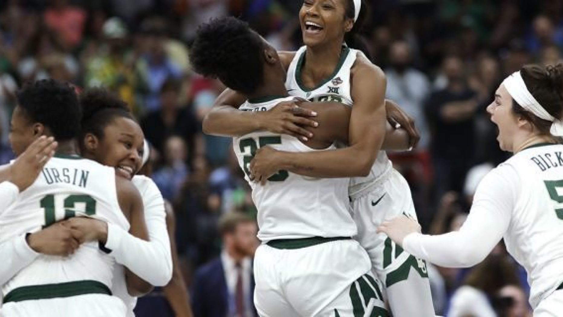 Baylor players celebrate after defeating Notre Dame in the Final Four championship game of the NCAA women
