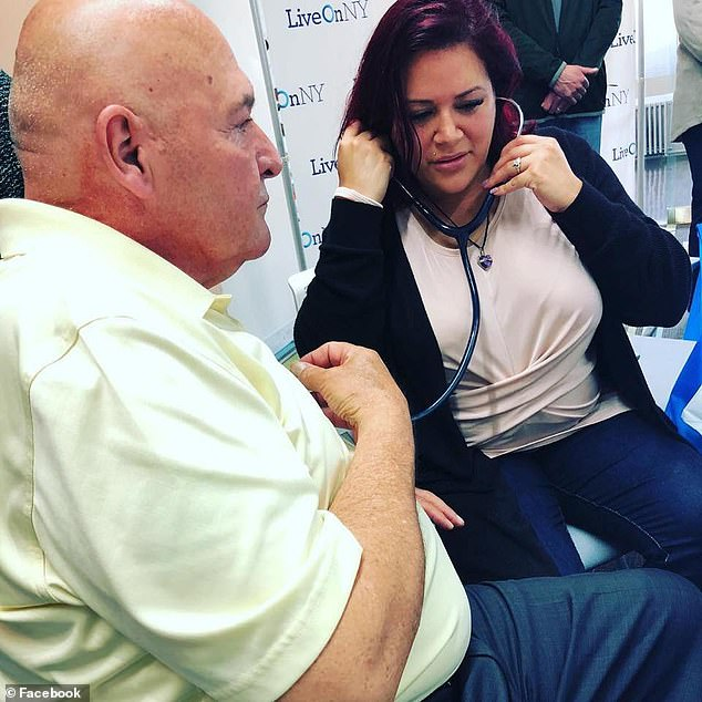 Robert Pascarelli (left), held a stethoscope to his chest on Monday so that Megan Erickson (right) could hear the heart her late husband, John, donated when he was killed suddenly in a car accident in 2016