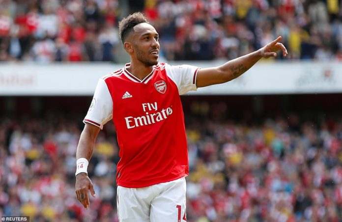 Pierre-Emerick Aubameyang points to the crowd after restoring Arsenal