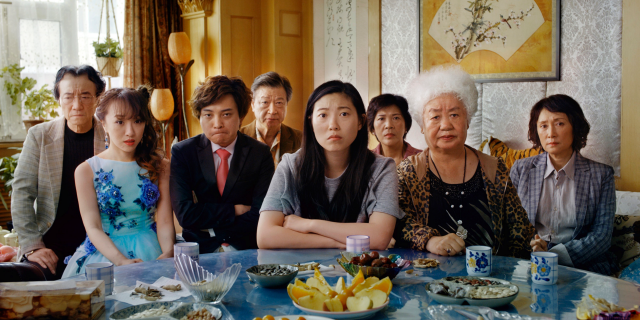"This image released by A24 shows Awkwafina, center, in a scene from ""The Farewell."" (A24 via AP)"