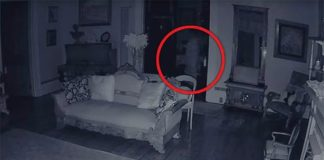 The ghost moving past the doorway