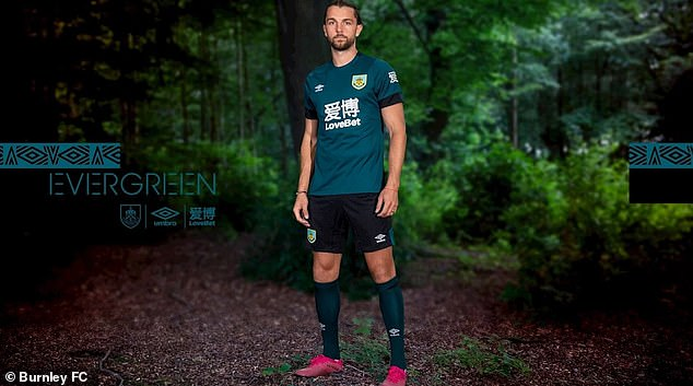Burnley have released their new green third, modelled here by forward Jay Rodriguez