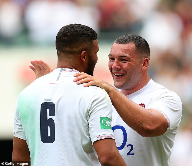 Ellis Genge celebrates with Lewis Ludlam after helping England beat Wales at Twickenham