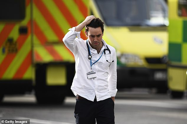 Half of key hospital doctors in the NHS aren't prepared to respond to a major incident, a medical survey has revealed. Pictured, a medic at the scene of Westminster terror attacks