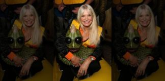 Actress Kathy Coleman poses with a Sleestak sculpture at an event in Las Vegas last month.