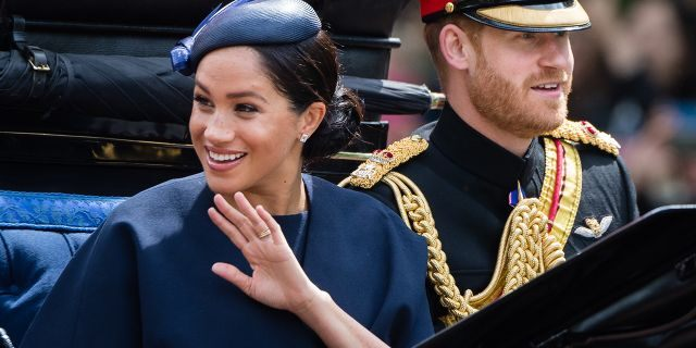 Prince Harry, Duke of Sussex and Meghan, Duchess of Sussex ride by carriage down during Trooping The Colour on June 8, 2019, in London. (Photo by Samir Hussein/Samir Hussein/WireImage)