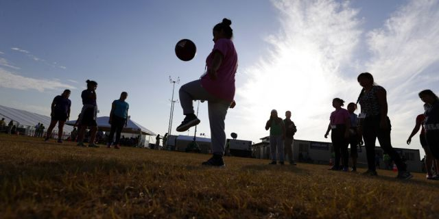 FILE: Immigrants play soccer at the U.S. government