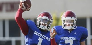 FILE - In this Monday, Aug. 5, 2019, file photo, Oklahoma quarterback Jalen Hurts (1) throws as quarterback Spencer Rattler watches during the NCAA college football team