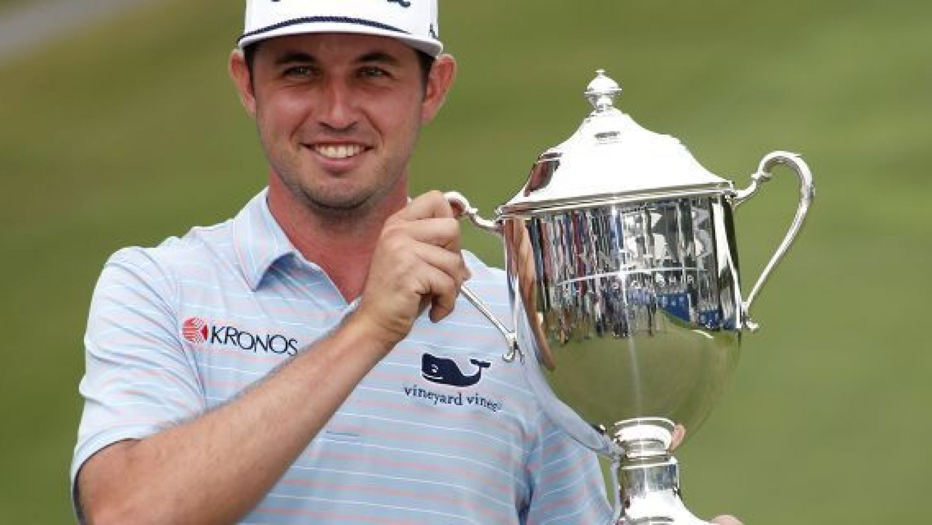 J. T. Poston holds the trophy after he won the Wyndham Championship golf tournament at Sedgefield Country Club in Greensboro, N.C., Sunday, Aug. 4, 2019. (AP Photo/Chris Seward)