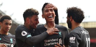 Roberto Firmino (centre right) smiles after scoring Liverpool