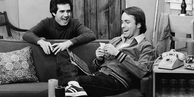 """John Ritter and Richard Kline share a laugh in a still from the television series, """"Three"""