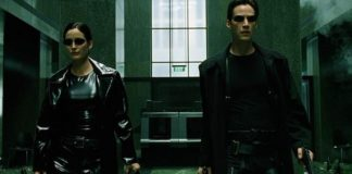 Carrie-Anne Moss as Trinity and Keanu Reeves as Neo.