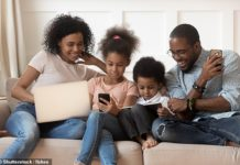 Between ages two and five, US doctors recommend kids spend just an hour with screens - but by age three, 25 percent are staring for four hours a day, NIH research reveals (file)