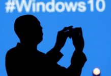 File photo - A Microsoft delegate takes a picture during the launch of the Windows 10 operating system in Kenya