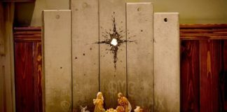 """A new artwork dubbed """"Scar of Bethlehem"""" by the artist Banksy is displayed in The Walled Off Hotel, in the West Bank city of Bethlehem, Sunday, Dec. 22, 2019. (AP Photo/Majdi Mohammed)"""
