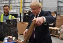 Boris Johnson packs boxes at factory in the west midlands.