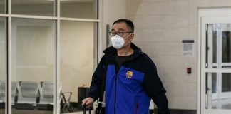 Travelers arriving to the US from China were seen on Friday wearing masks amid the coronavirus outbreak. These can help, but experts say other prevention methods are more important to safe, healthy travel