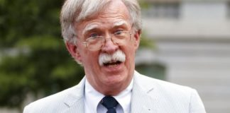 FILE - In this July 31, 2019 file photo, then National security adviser John Bolton speaks to media at the White House in Washington. Bolton says he