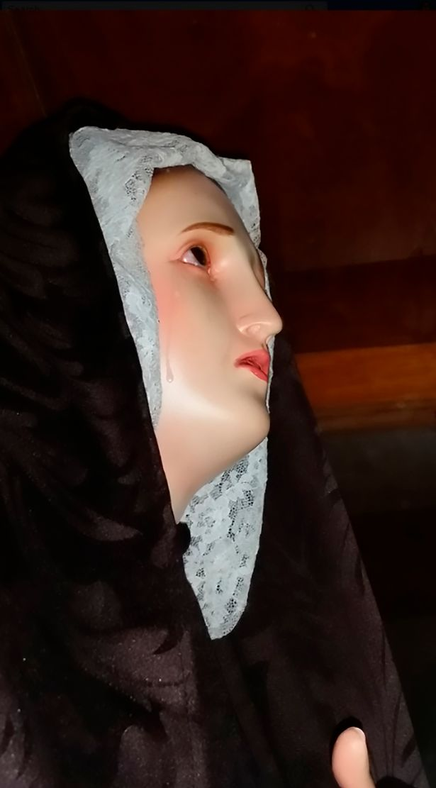 This is the moment a statue of the Virgin Mary appears to weep real tears