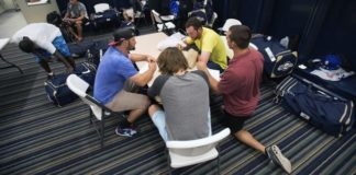 FILE - In this April 8, 2015, file photo, members of the Biloxi Shuckers minor league baseball team eat lunch before practice. (AP Photo/Michael Spooneybarger, File)