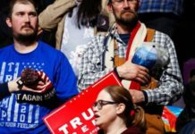 Supporters standing for the Pledge of Allegiance before an appearance by President Trump at his campaign rally Thursday in Colorado Springs, Colo. (AP Photo/David Zalubowski)
