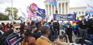 LGBT supporters gather in front of the U.S. Supreme Court, Tuesday, Oct. 8, 2019, in Washington. This was one of the first days of oral arguments of its current term. It