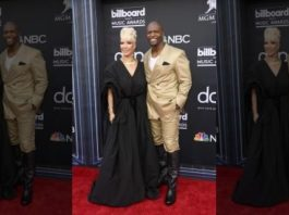 Rebecca King-Crews, in a black gown, and Terry Crews, in a gold suit, were all smiles at the Billboard Music Awards.