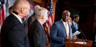 Sen. Tim Scott, R-S.C., accompanied by Senate Majority Leader Mitch McConnell of Ky., second from left, and others, speaks at a news conference to announce a Republican police reform bill on Capitol Hill, Wednesday, June 17, 2020, in Washington. (AP Photo/Andrew Harnik)