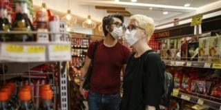 Shoppers wearing face masks as they shop in Islington, on 11 July 2020