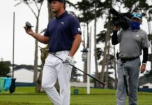 Bryson DeChambeau holds his broken driver on the seventh hole during the first round of the PGA Championship golf tournament at TPC Harding Park Thursday, Aug. 6, 2020, in San Francisco. (AP Photo/Jeff Chiu)