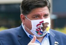 Illinois Gov. J.B. Pritzker meets with people at City Market in Rockford, Ill.