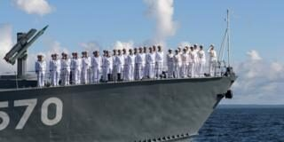 Russian sailors lined up onboard a small missile ship