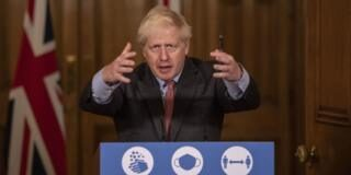 Boris Johnson speaks at the podium for a No 10 press office - it reads