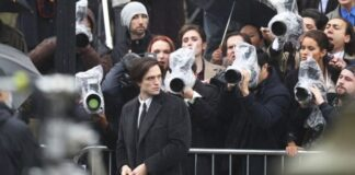 Actor Robert Pattinson during filming of