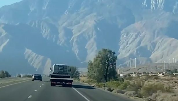 A worker spotted a white flat disc hovering above the highway in front of Mount San Jacinto