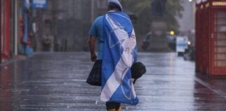 Scottish independence supporter walking along Edinburgh