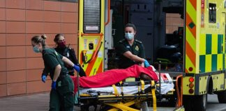 Paramedics transport a patient from the ambulance to the emergency department at the the Royal London Hospital