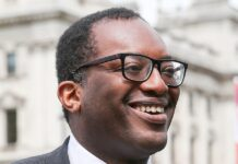 Looking ahead: The Confederation of British Industry has written to Kwasi Kwarteng (pictured) demanding the Government helps companies prepare for exiting lockdown