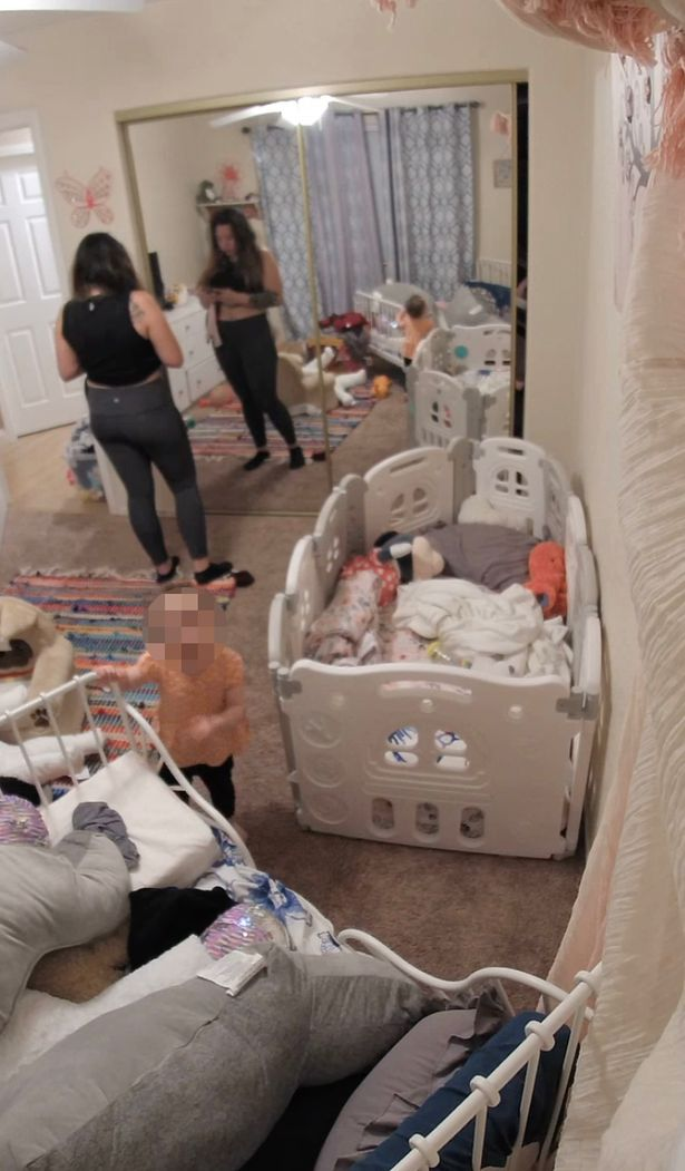 Footage of the toddler climbing up to her bed and waving at the camera