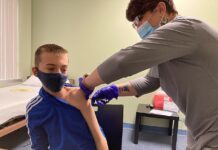 Nicky Byers, 12, from Kentucky in the United States is receiving the Modena Covid-19 jab as part of a clinical trial to assess the effectiveness of vaccinating children to reduce the level of infection in the community