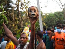 Human skulls are paraded around the city in West Bengal as locals take photographs