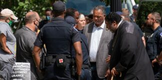 The Rev. Jesse Jackson, second from right, and Bishop William Barber II, second from left, stand outside the Hart Senate Office building in Washington, blocking the street, Wednesday, June 23, 2021. (Associated Press)