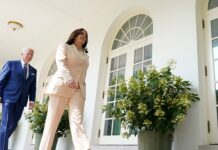 President Joe Biden and Vice President Kamala Harris walk out to an event in the Rose Garden of the White House in Washington, Monday, July 26, 2021. (Associated Press)