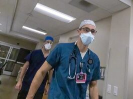 Two Oregon counties, Josephine and Tillamook, have requested refrigerated freezers to help store dead bodies as their hospitals are overwhelmed by COVID-19 patients. Pictured: Two Josephine County nurses walk through the emergency department on August 19