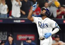 Randy Arozarena #56 of the Tampa Bay Rays celebrates his solo home run in the fifth inning against the Boston Red Sox during Game 1 of the American League Division Series at Tropicana Field on October 07, 2021 in St Petersburg, Florida.
