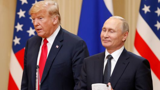 President Donald Trump and Russian President Vladimir Putin arrive for a joint news conference after their meeting in Helsinki, July 16, 2018.